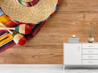 Mexican sombrero and blanket on pine wood floor