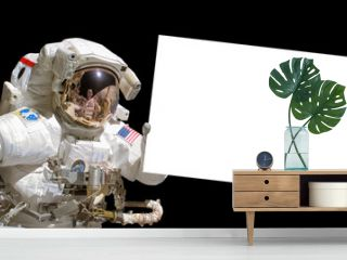 Astronaut in space holding a white blank board - elements of this image are provided by NASA