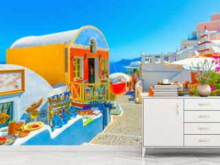 Typical colorful narrow street in Oia the most beautiful village of Santorini island in Greece