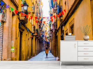 woman walks in old street in old center of barcelona in spring day