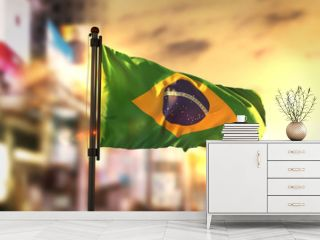Brazil Flag Against City Blurred Background At Sunrise Backlight