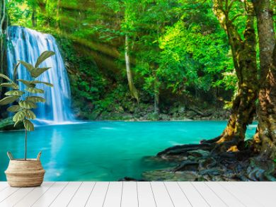 The beautiful waterfall at deep tropical rain forest.