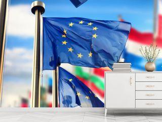 EU flags waving over blue sky. Brussels, Belgium