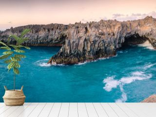 Panorama of the stunningly beautiful lava caves and cliffs on the coast in Los Hervideros after sunsett. Lanzarote. Canary Islands. Spain