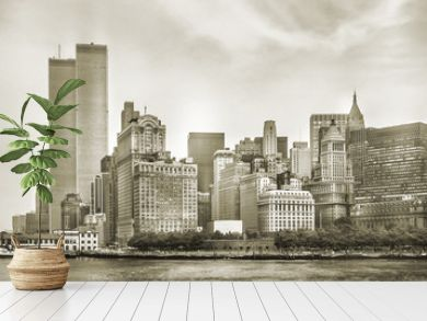 New York City skyline from NJ with World Trade Center featured as landmark of Twin Towers, destroyed in September 11, 2001. Sepia background, vintage style. Lower Manhattan in NYC, United States.