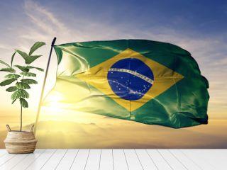 Brazil brazilian flag textile cloth fabric waving on the top sunrise mist fog