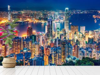 Scenic view over Hong Kong island, China, by night. Multicolored nighttime skyline with illuminated skyscrapers seen from Victoria Peak