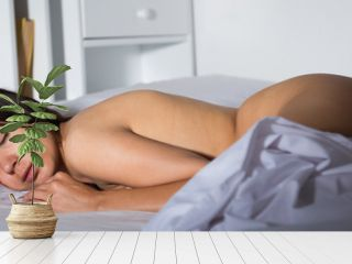 Sexy young  woman with naked body sleeping in bedroom