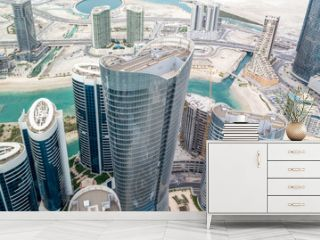 Aerial drone shot of skyscrapers and towers in the city - Abu Dhabi Al Reem island towers