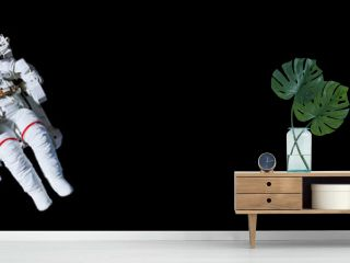 Astronaut with a jetpack isolated on black panoramic background with copy space -  Elements of this image are furnished by NASA