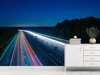 Motorway fast traffic light trails at night
