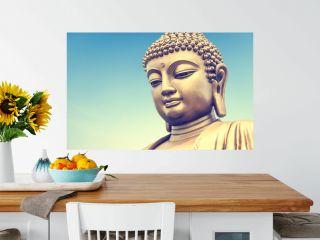 Buddha statue on the blue sky