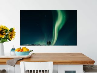 Couple watching northern lights in Iceland