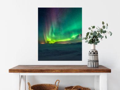 Northern lights aurora borealis in the winter