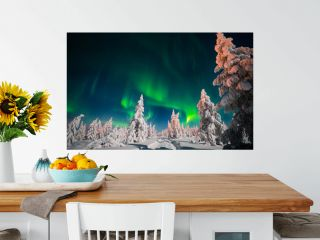 Winter night landscape with forest, road and northern light over the scene